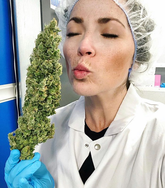 WeedMD Communications Manager, Victoria Dekker savouring the aroma of cannabis